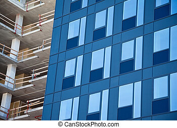 glass facade and construction site - new glass facade and...