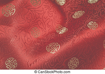 Fragment of red chinese silk