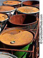 Old rusty waste barrels