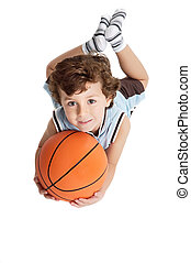 adorable boy playing the basketball - boy with a basketball...