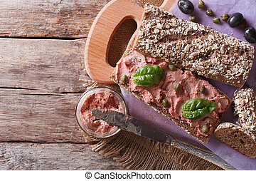 Sandwich with pate, capers and basil horizontal top view -...
