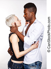 Interracial love - Multiracial cute couple hugging each...