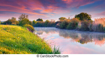 Colorful summer sunrise on the river