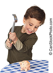 adorable boy breaking the money box - photo of an adorable...