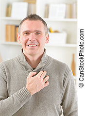 EFT tapping points - Man doing EFT on the under collarbone....