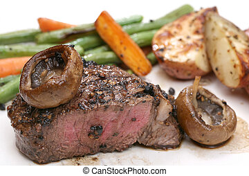 Filet dinner with mushrooms - Filet dinner on plate with...