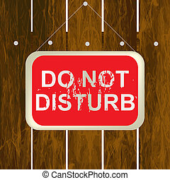 DO NOT DISTURB sign hanging on a wooden fence