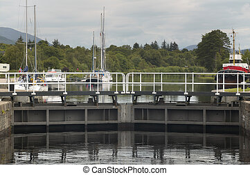 Caledonian canal with sailboats and lock in Scotland....