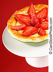 Strawberry and custard tart on a cakestand - Strawberry and...
