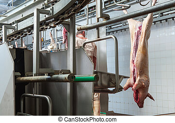 butcher in meat industry interior, factory for production of...
