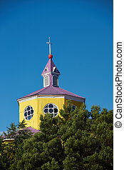Historic Church of Chilo - Bright yellow and purple painted...