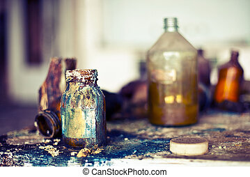 Old used potion bottles. Abandoned shop with chemicals