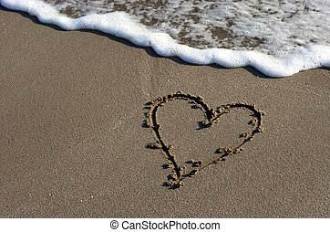 Heart on beach sand background