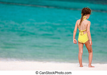 Little girl on vacation - Back view of a little girl at...