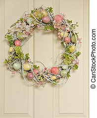 Easter egg wreath on a wooden door.