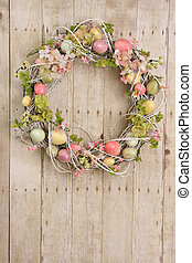 Easter egg wreath on a wooden background. Also available in...