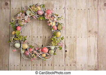 Easter egg wreath on a wooden background Also available in...