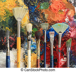 Artist brushes on an oil painting background