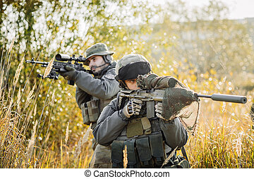 Army Rangers patroling on a battlefield - Army Rangers...