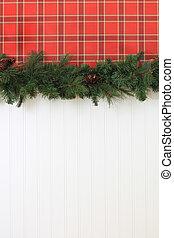 Christmas garland hanging on the wall.
