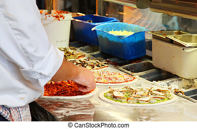 Making Pizza - Chef Making Assorted Pizzas in a Restaurant