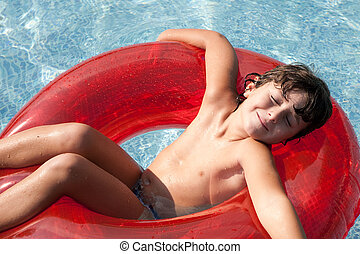 relaxed child in the pool