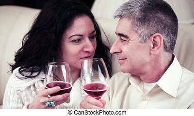 Couple Talking Closely And Toasting