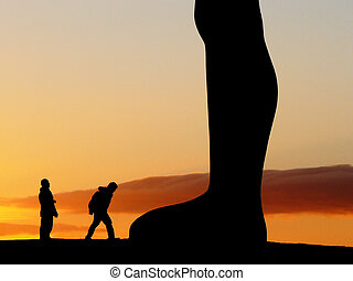 Exploring - Silhouette of a two men walking around the Angel...