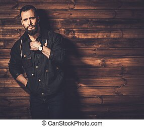Handsome man with beard  wearing waxed canvas jacket