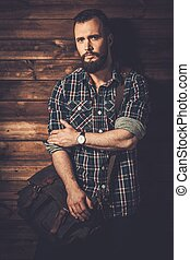 Man with wearing checkered  shirt and messenger bag