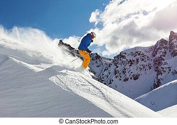 Male freerider skier - Male skier on downhill freeride with...