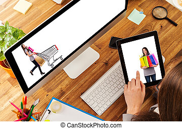 E-shopping concept - Woman working on tablet placed on...