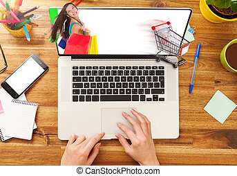 E-shopping concept - Woman working on laptop placed on...