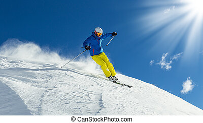Male freerider skier - Male skier on downhill freeride with...