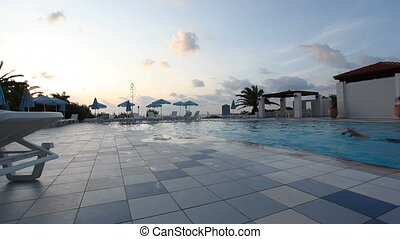 swimming pool by sunset
