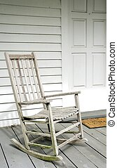 White Rocking Chair - Old white rocking chair on wooden...