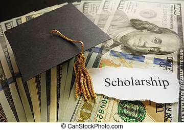 Scholarship note - Mini graduation cap on cash with...