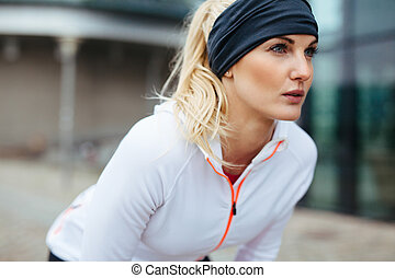 Sporty woman on outdoor workout looking confident - Young...