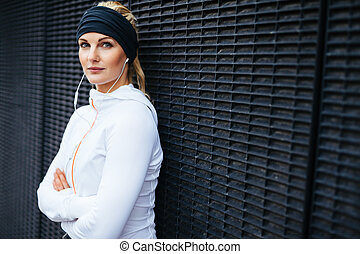 Fit female athlete taking a break for workout