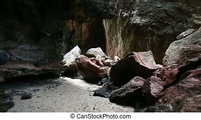 sun light in cave with sand bottom - the sun light in dark...