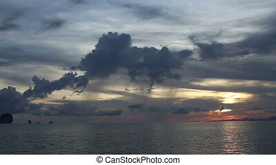 motor boat sail on the sea at sunset with cloud