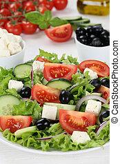 Healthy vegetarian eating Greek salad in bowl with tomatoes,...