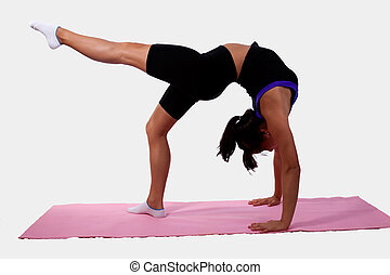 Young flexible woman wearing workout attire bending...