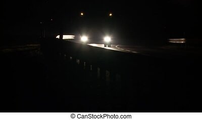 Car Lights at night with shadow - video footage of a car at...