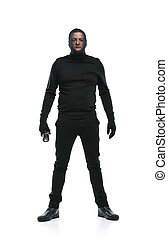 Thief in black mask - Thief in action with balaclava on his...