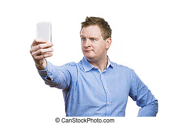 Man taking selfie of himself - Man making funny faces while...