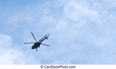 Modern helicopter flying in the blue sky HD footage.