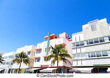 Art deco architecture of Miami Beach, Florida. Street with palms and colorful buildings.