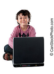 Happy child sitting with a laptop on a over white background