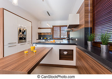 Orange juice on countertop in luxury kitchen